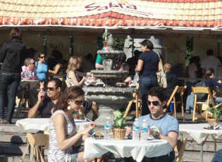 Conceived, designed and staged a Mediterranean Cafe cafe with fountains, palm trees, vinyl of beach, waves and sand in Union Square Park, NYC.